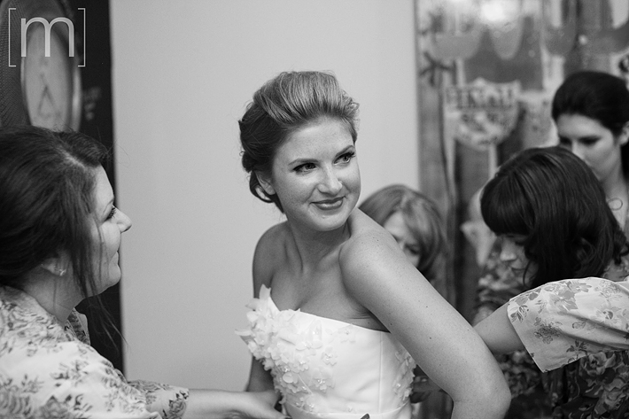 A photo of the bride getting into dress