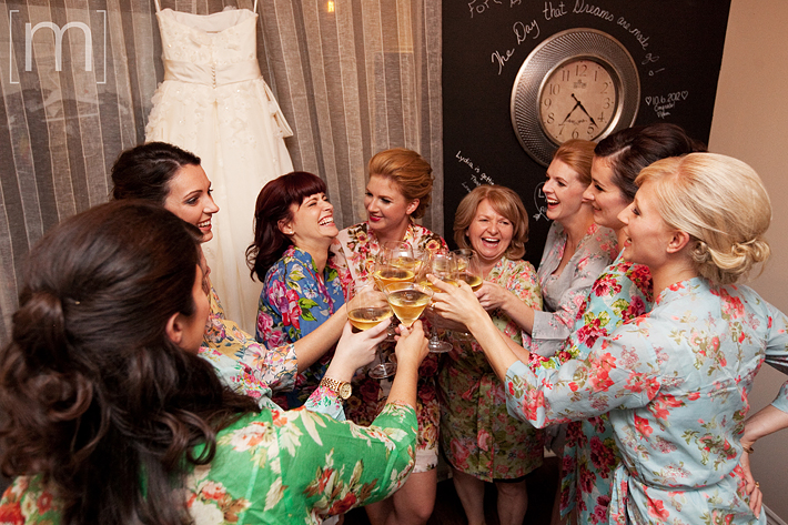A photo of Bride and Bridesmaids cheering with kimonos on