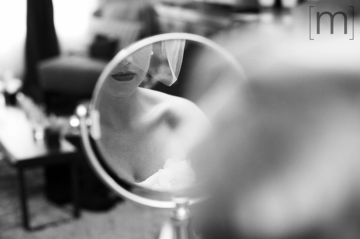 A photo of the bride's lips reflected in mirror