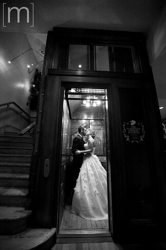 A photo of the bride and groom in an elevator at gladstone hotel
