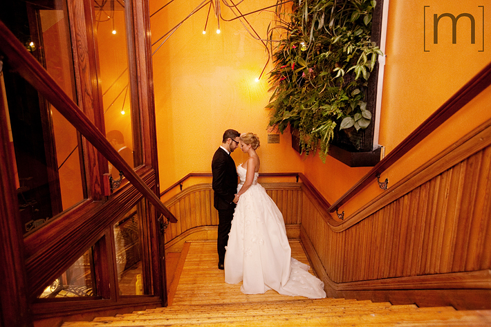 A portait of bride and groom on stairs at the gladstone hotel