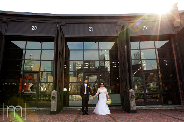 a photo of the bride and groom at Steamwhistle Brewery