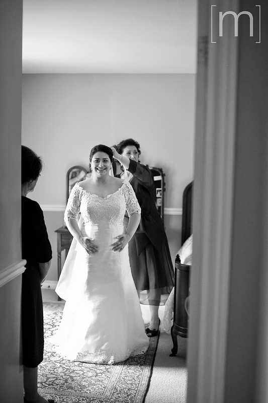 a photo of the happy bride getting ready in toronto