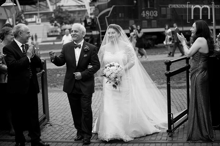 a photo of the bride and father walking down the aisle