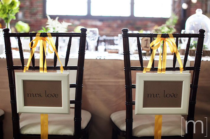 a photo of the bride and grooms chairs at the reception