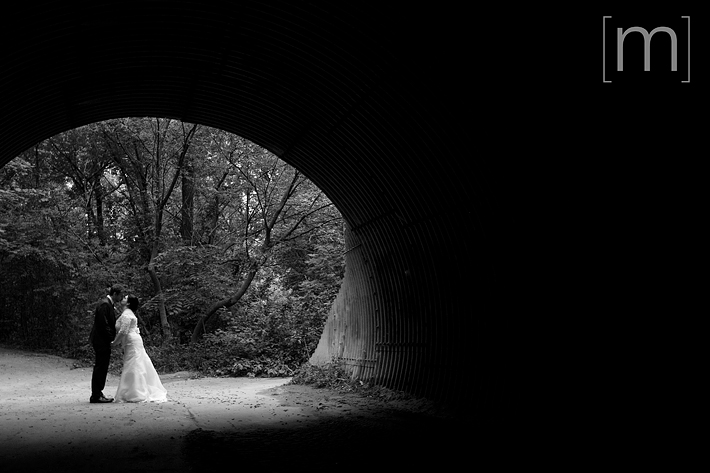 a photo of the bride and groom in a sewer at Steamwhistle Brewery