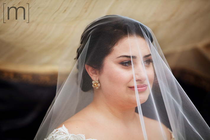 a photo of the veiled bride at the persian ceremony
