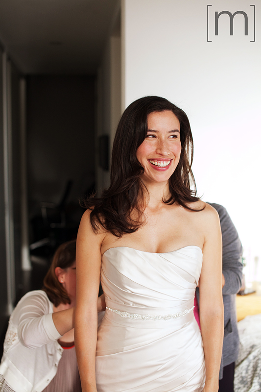 A photo of the bride smiling at canoe restaurant