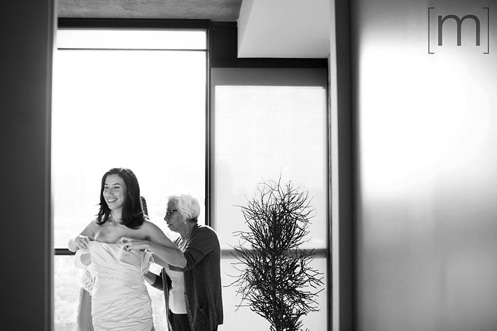 A photo of the bride getting ready at canoe restaurant