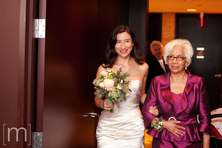 A photo of the bride walking in at canoe restaurant