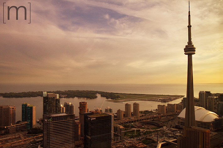 A photo of the top of canoe restaurant of the cn tower at sunset