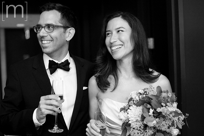 A photo of the happy bride and groom at canoe restaurant