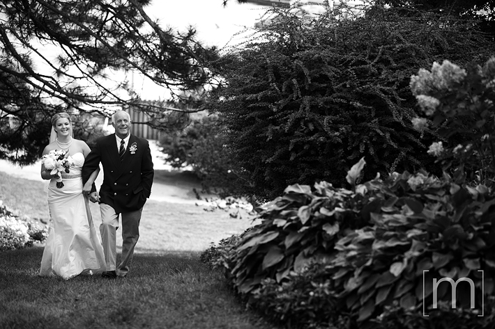 a photo of a bride and father walking at erchless estate in oakville