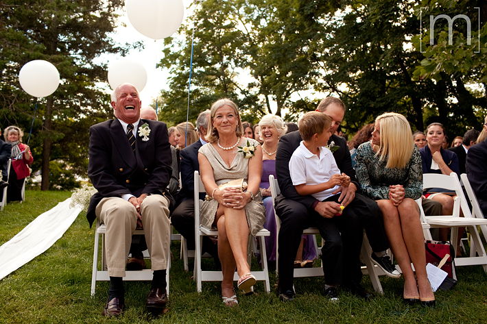 a photo of the family laughing at a wedding at erchless estate in oakville