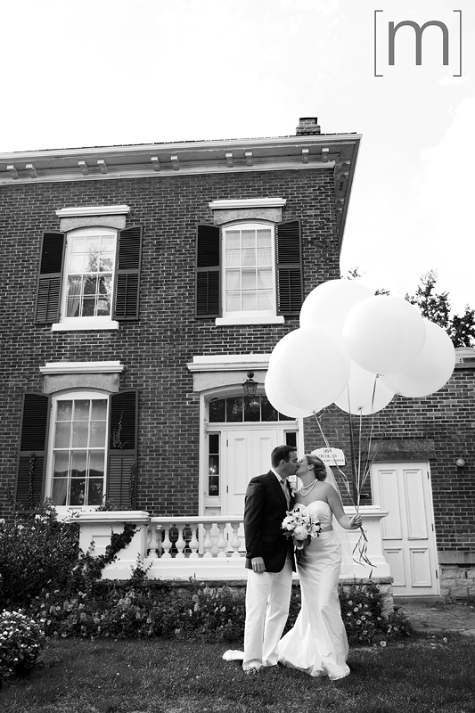 a photo of a bride and groom with balloons at erchless estate in oakville