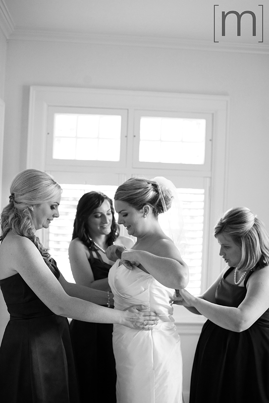 a photo of the bride getting ready at the oakville club