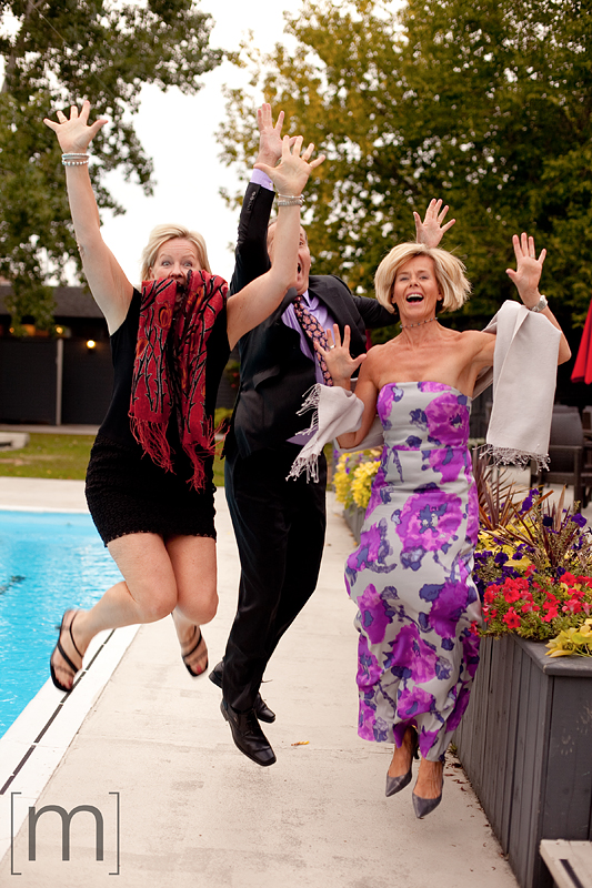 a photo of guests jumping at the oakville club