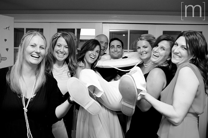 a photo of guests laughing at a wedding reception at the oakville club