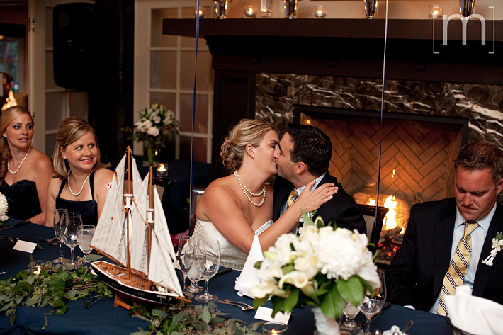 a photo of a newlywed couple kissing at the oakville club