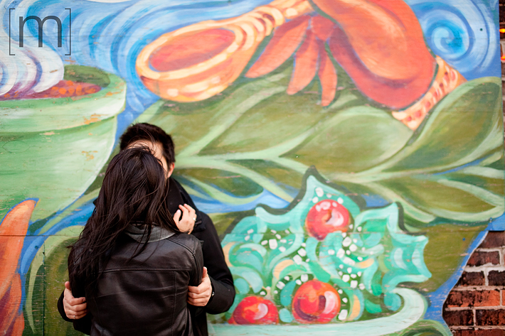 a photo of a couple against a wall at an e-shoot at liberty village toronto