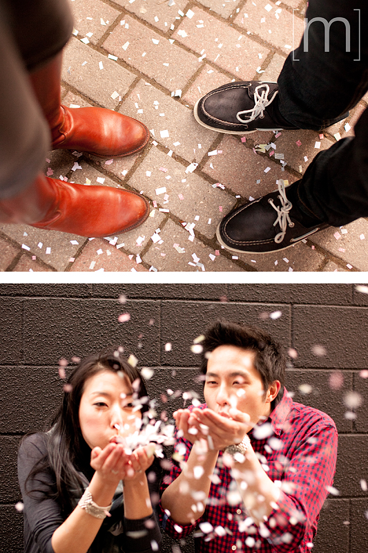 a photo of a couple blowing confetti at an e-shoot at liberty village toronto