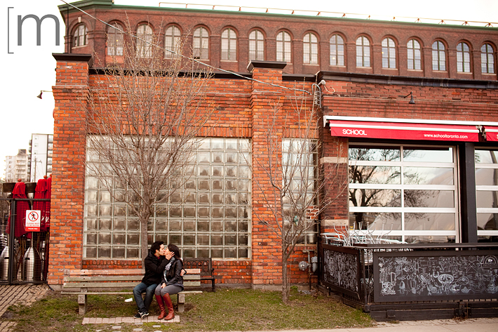 a photo of a couple kissing at an e-shoot at liberty village toronto