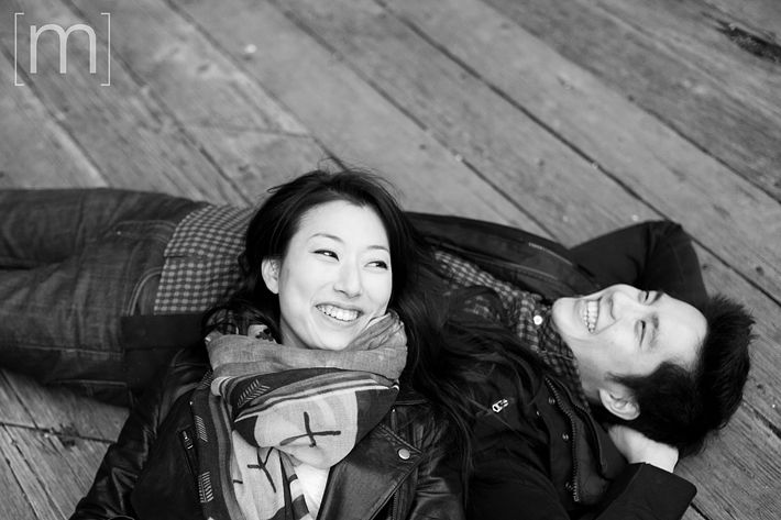 a photo of a couple laying down at an e-shoot at liberty village toronto