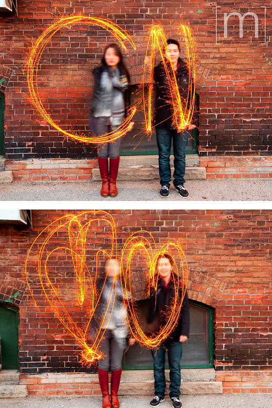 a photo of a couple with sparklers at an e-shoot at liberty village toronto