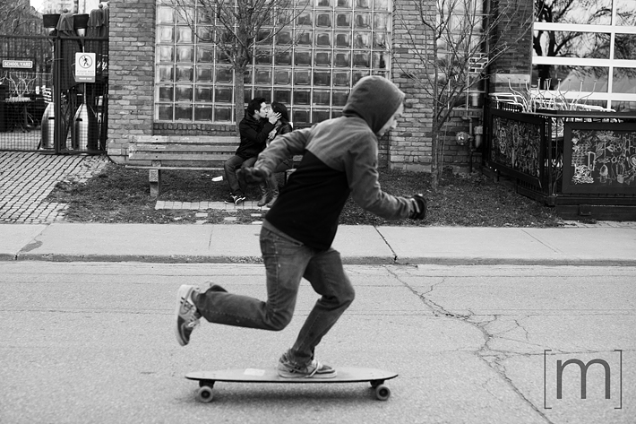 a photo of a skateboarder at an e-shoot at liberty village toronto