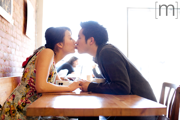 a photo of a couple kissing at an e-shoot at manic coffee toronto