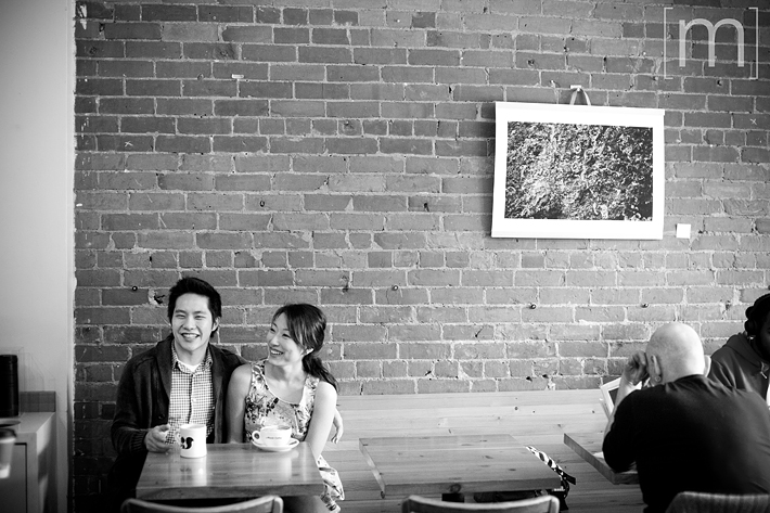 a photo of a couple laughing at an e-shoot at manic coffee toronto
