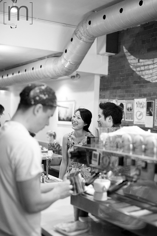 a photo of a couple ordering coffee at an e-shoot at manic coffee toronto