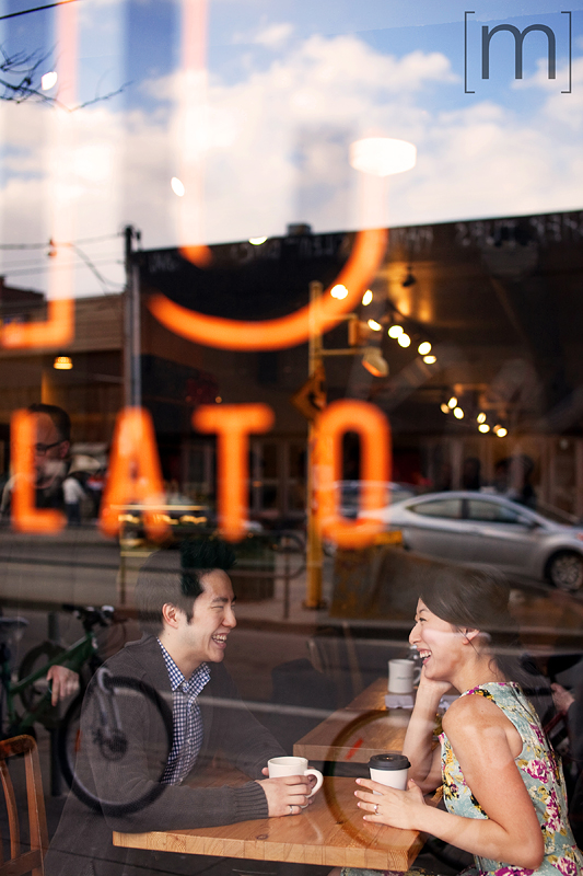 a photo of a couple laughing through reflection at an e-shoot at manic coffee toronto