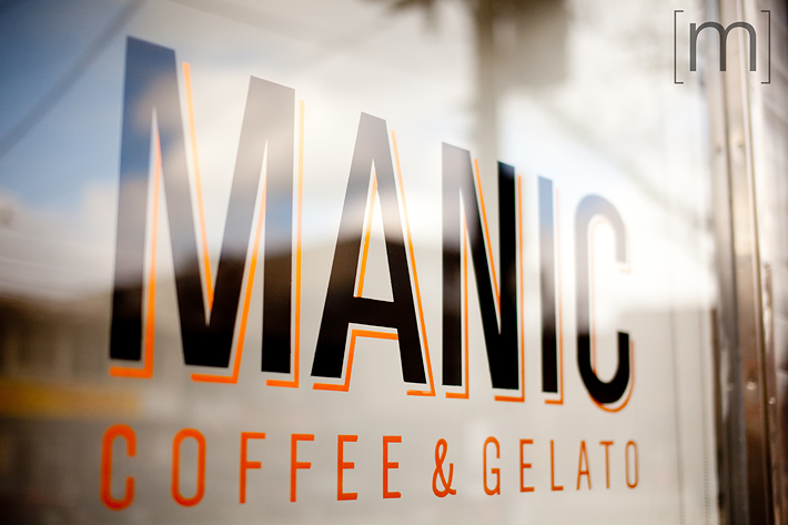 a photo of the sign at an e-shoot at manic coffee toronto