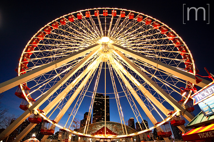 a travel photo of a ferris wheel at night in chicago