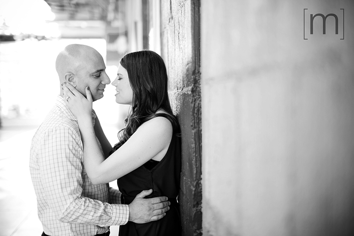 a photo of a couple against a wall at an eng shoot at wychwood barns