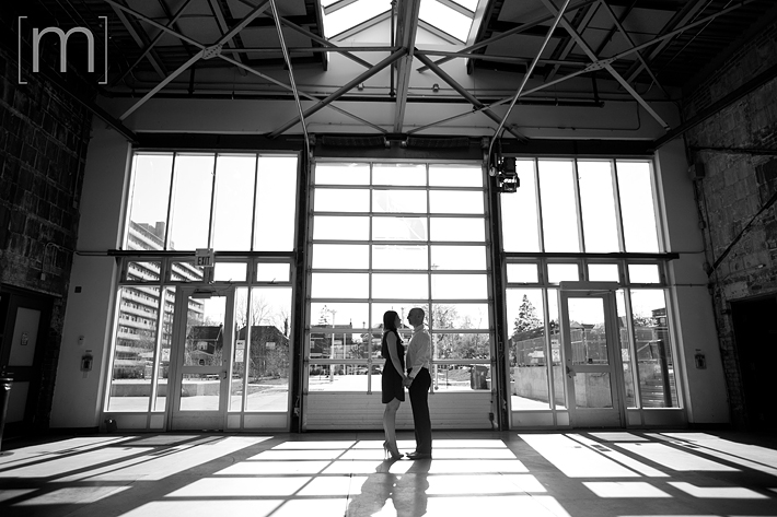 a photo of a couple holding hands at an eng shoot at wychwood barns