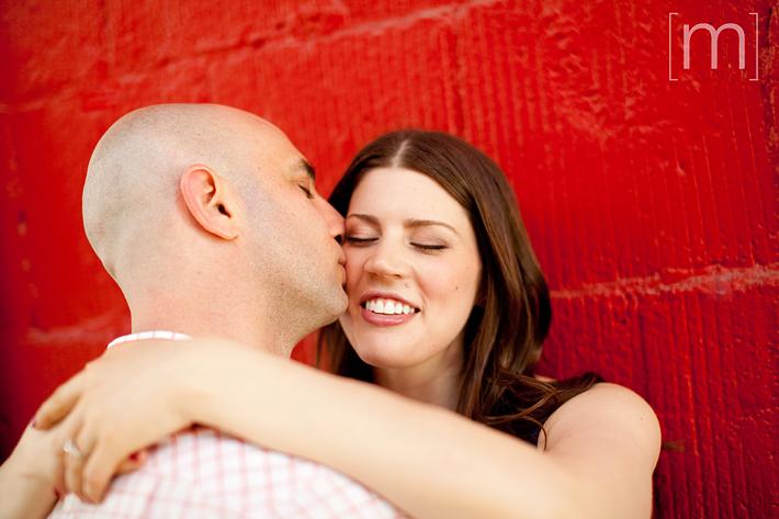 a photo of a couple kissing at an eng shoot at wychwood barns