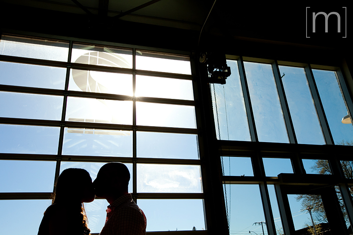 a silhouette of a couple kissing at an eng shoot at wychwood barns