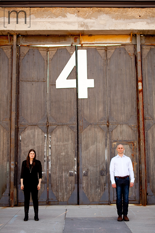 a photo of a couple standing side by side at an eng shoot at wychwood barns