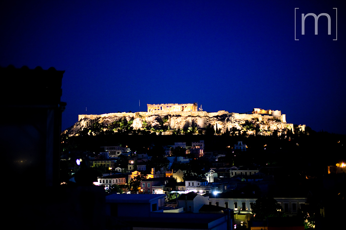 a travel photo of the parthenon at night in athens greece