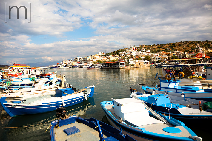 a travel photo of boats in the harbour in crete greece