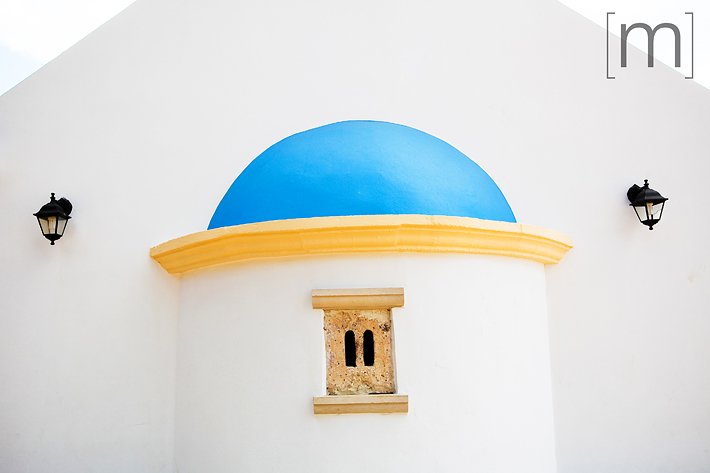 a travel photo of a church in crete greece