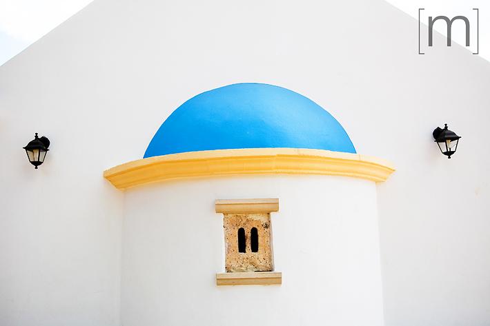 a travel photo of a church in crete greece