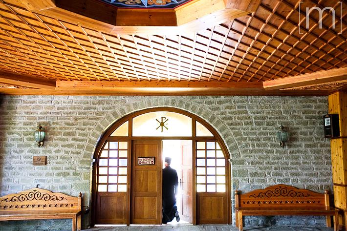a travel photo of church doorway in meteora greece