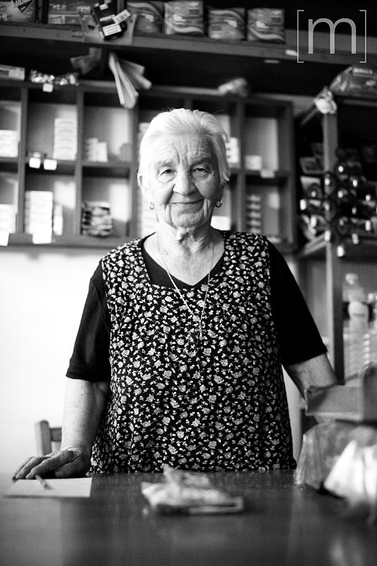 a travel portrait of a woman in meteora greece