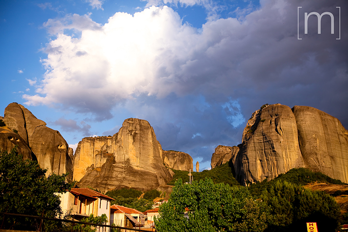 a travel photo of rock formations at sunset in meteora greece