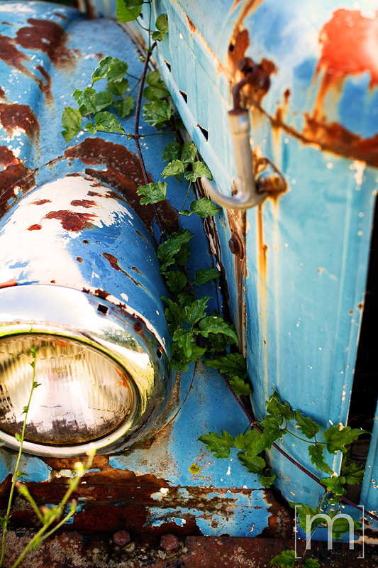a travel photo of a rusty car in meteora greece