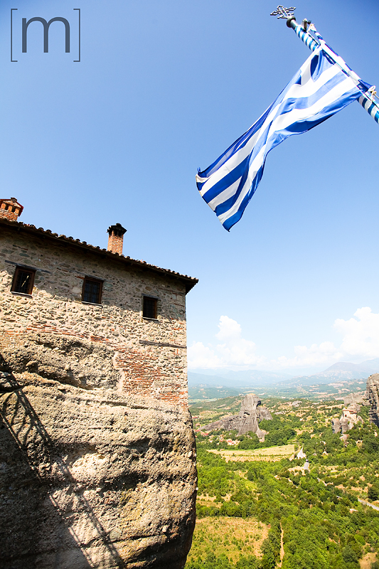a travel photo of the top of a monastery in meteora greece