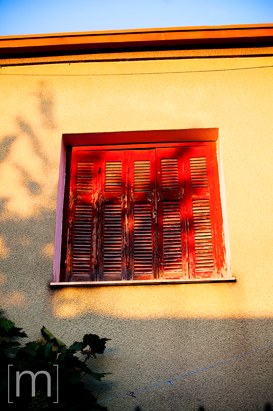 a travel photo of a window at sunset in meteora greece